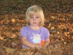 Brynn just couldn't resist playing among the Fall leaves!